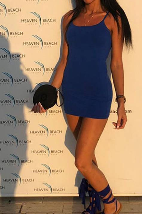 Sahara posing in a blue dress